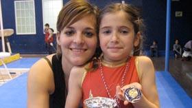 Oréane et Morgane Tato Gonzalez, son entraîneur de gym en 2008